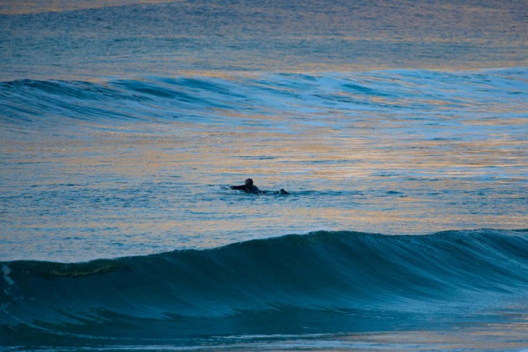 A surfer paddles out in Unstad along the northern Atlantic Ocean on March 12, 2017. (OLIVIER MORIN/AFP/Getty Images)