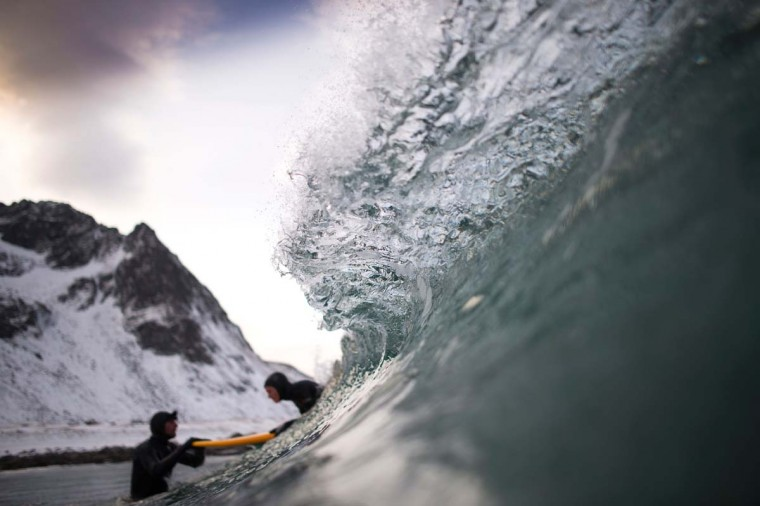 Norwegian surfer Tommy Olsen is seen in the water as he gives a surfing lesson to beginners in Flakstad, near Unstad along the northern Atlantic Ocean on March 9, 2017. (OLIVIER MORIN/AFP/Getty Images)