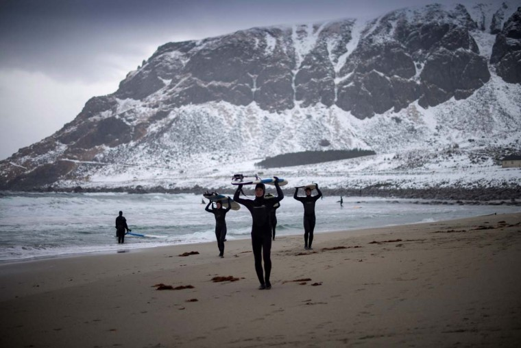 Novice surfers leave the beach at Unstad along the northern Atlantic Ocean on March 12, 2017. (OLIVIER MORIN/AFP/Getty Images)