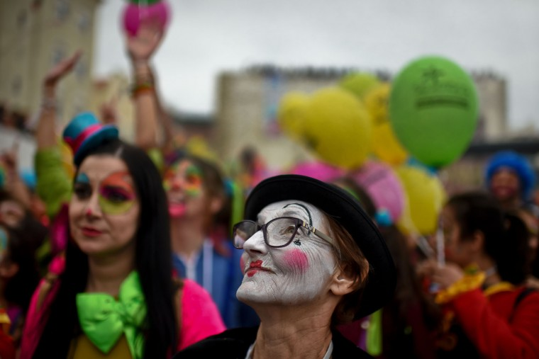 A woman with her face painted as a clown takes part on the Carnival Clown's Parade at Sesimbra village on February 27, 2017. (Patricia de Melo Moreira/AFP/Getty Images)