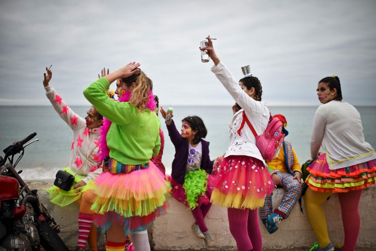 People dressed as clowns stand near the beach during the Carnival Clown's Parade at Sesimbra village on February 27, 2017. (Patricia de Melo Moreira/AFP/Getty Images)