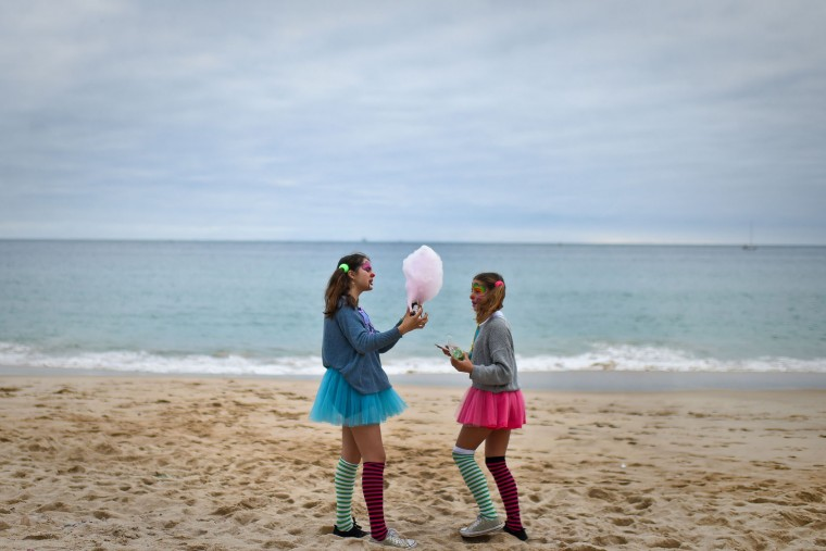 Two girl dressed as clowns stand on the beach during the Carnival Clown's Parade at Sesimbra village on February 27, 2017. (Patricia de Melo Moreira/AFP/Getty Images)