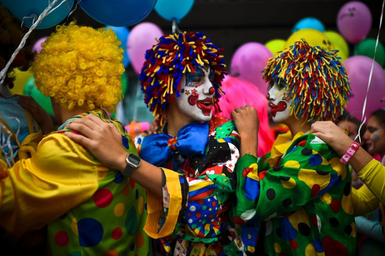People dressed as clowns take part on the Carnival Clown's Parade at Sesimbra village on February 27, 2017. (Patricia de Melo Moreira/AFP/Getty Images)