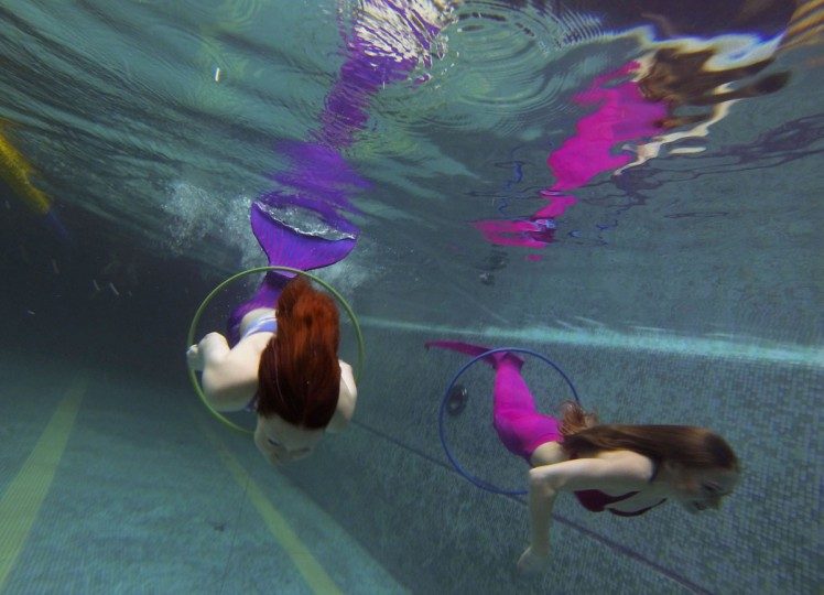 A picture taken on March 16, 2017 shows women practicing swimming with mermaid tails at a mermaid training school in a pool in Moscow. Russian women who have dreamt of becoming a mermaid since their youngest years, start turning their fantasies into reality with a new type of fitness mermaid swimming. (NATALIA KOLESNIKOVA/AFP/Getty Images)