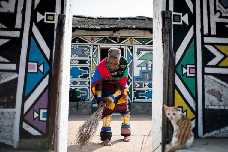 South African artist Esther Mahlangu, 81, sweeps the floor of her home in Mabhoko Village, Siyabuswa, Mpumalanga on March 6, 2017. Mahlangu recently opened her exhibition at the Melrose Gallery where her series of artwork inspired by Nelson Mandela was unveiled on March 1. The artist has produced six paintings reproduced from drawings created by Mandela in her signature Ndebele style. The exhibition will include previous work by Mahlangu. (GULSHAN KHAN/AFP/Getty Images)