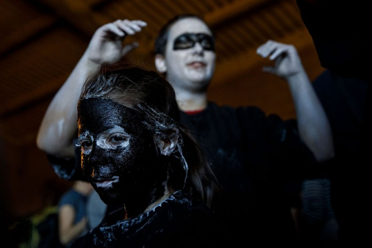 """A girl with grease smeared on her face to represent """"Diablos de Luzon"""" (Luzon's devils) performs during the carnival in Luzon, near Guadalajara, on February 25, 2017.(CESAR MANSO/AFP/Getty Images)"""