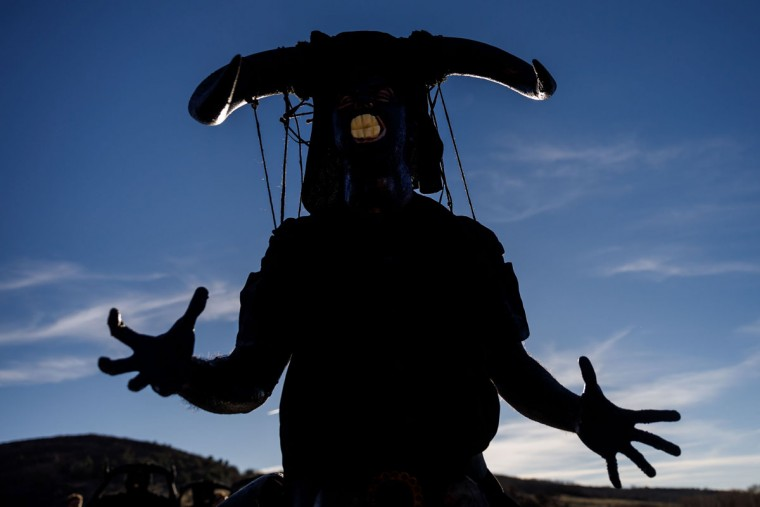 """A man sporting horns on his head and grease on his face to represent """"Diablos de Luzon"""" (Luzon's devils) performs during the carnival in Luzon, near Guadalajara, on February 25, 2017. (CESAR MANSO/AFP/Getty Images)"""