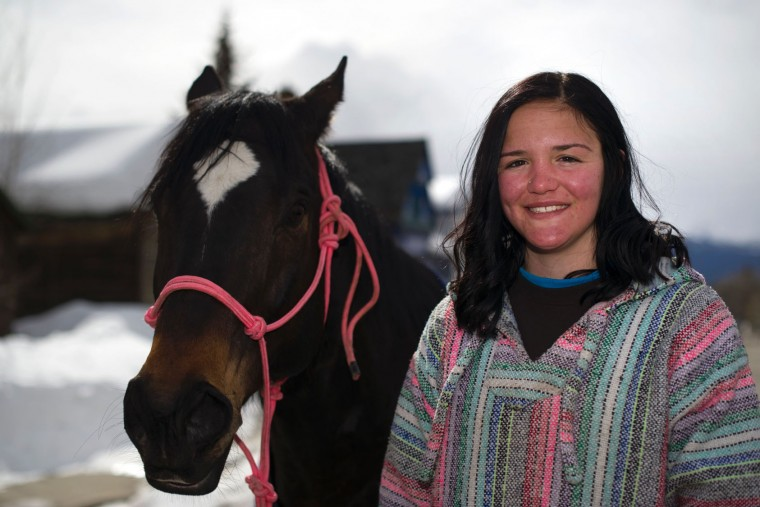 Rider Savanah McCarthy of Aztec, New Mexico, poses for a portrait with her horse Tank after finishing in 1st place during the 68th annual Leadville Ski Joring weekend competition on Saturday, March 5, 2017 in Leadville, Colorado. McCarthy, 17, races in the challenging Open Division where she is a dominant force. Skijoring, which has its origins as a competitive sport in Scandinavia, has been adapted over the years to include a team made up of a rider and skier who must navigate jumps, slalom gates, and the spearing of rings for points. Leadville, with an elevation of 10,152 feet (3,094 m), the highest incorporated city in North America, has been hosting skijoring competitions since 1949. (Jason Connolly/AFP/Getty Images)