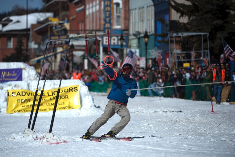 Skier Bruce Stott reaches for the final ring while competing in the 68th annual Leadville Ski Joring weekend competition on Saturday, March 4, 2017 in Leadville, Colorado. Skijoring, which has its origins as a competitive sport in Scandinavia, has been adapted over the years to include a team made up of a rider and skier who must navigate jumps, slalom gates, and the spearing of rings for points. Leadville, with an elevation of 10,152 feet (3,094 m), the highest incorporated city in North America, has been hosting skijoring competitions since 1949. (Jason Connolly/AFP/Getty Images)