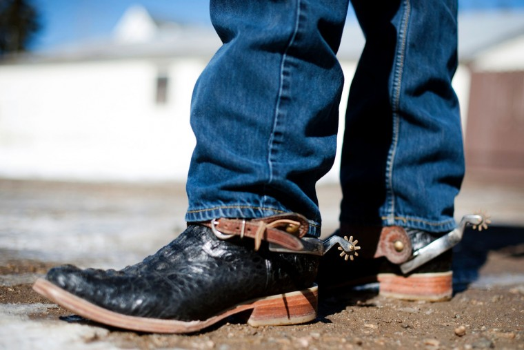 A rider displays his ornate cowboy boots and spurs before riding in the 68th annual Leadville Ski Joring weekend competition on Saturday, March 4, 2017 in Leadville, Colorado. Skijoring, which has its origins as a competitive sport in Scandinavia, has been adapted over the years to include a team made up of a rider and skier who must navigate jumps, slalom gates, and the spearing of rings for points. Leadville, with an elevation of 10,152 feet (3,094 m), the highest incorporated city in North America, has been hosting skijoring competitions since 1949. (Jason Connolly/AFP/Getty Images)