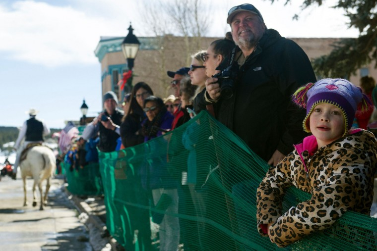 Spectators young and old watch the 68th annual Leadville Ski Joring weekend competition on Saturday, March 4, 2017 in Leadville, Colorado. Skijoring, which has its origins as a competitive sport in Scandinavia, has been adapted over the years to include a team made up of a rider and skier who must navigate jumps, slalom gates, and the spearing of rings for points. Leadville, with an elevation of 10,152 feet (3,094 m), the highest incorporated city in North America, has been hosting skijoring competitions since 1949. (Jason Connolly/AFP/Getty Images)