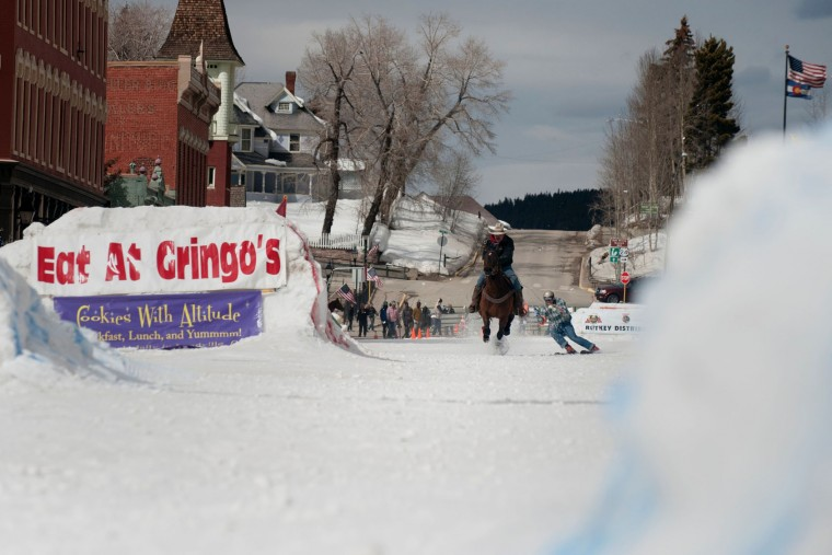 Rider Jeff Dahl races down Harrison Avenue towing skier and son Greg Dahl during the 68th annual Leadville Ski Joring weekend competition on March 5, 2017 in Leadville, Colorado. Skijoring, which has its origins as a competitive sport in Scandinavia, has been adapted over the years to include a team made up of a rider and skier who must navigate jumps, slalom gates, and the spearing of rings for points. Leadville, with an elevation of 10,152 feet (3,094 m), the highest incorporated city in North America, has been hosting skijoring competitions since 1949. (Jason Connolly/AFP/Getty Images)