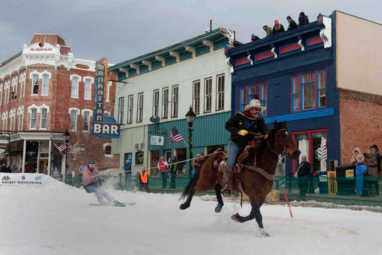 Rider Jeff Dahl races down Harrison Avenue towing skier and son Jason Dahl during the 68th annual Leadville Ski Joring weekend competition on March 5, 2017 in Leadville, Colorado. Skijoring, which has its origins as a competitive sport in Scandinavia, has been adapted over the years to include a team made up of a rider and skier who must navigate jumps, slalom gates, and the spearing of rings for points. Leadville, with an elevation of 10,152 feet (3,094 m), the highest incorporated city in North America, has been hosting skijoring competitions since 1949. (Jason Connolly/AFP/Getty Images)