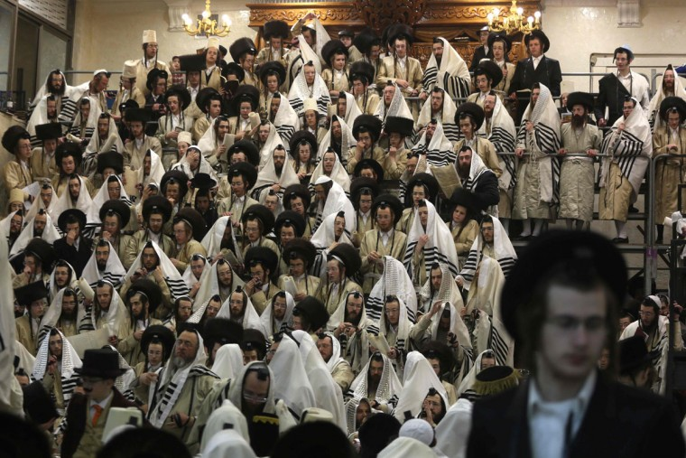 Ultra-Orthodox Jewish men read the book of Esther in their synagogue in Jerusalem's Mea Shearim ultra-Orthodox neighbourhood on March 13, 2017 during the religious holiday of Purim. The carnival-like Purim holiday is celebrated with parades and costume parties to commemorate the deliverance of the Jewish people from a plot to exterminate them in the ancient Persian Empire 2,500 years ago, as recorded in the Biblical Book of Esther. (AFP PHOTO / MENAHEM KAHANA)