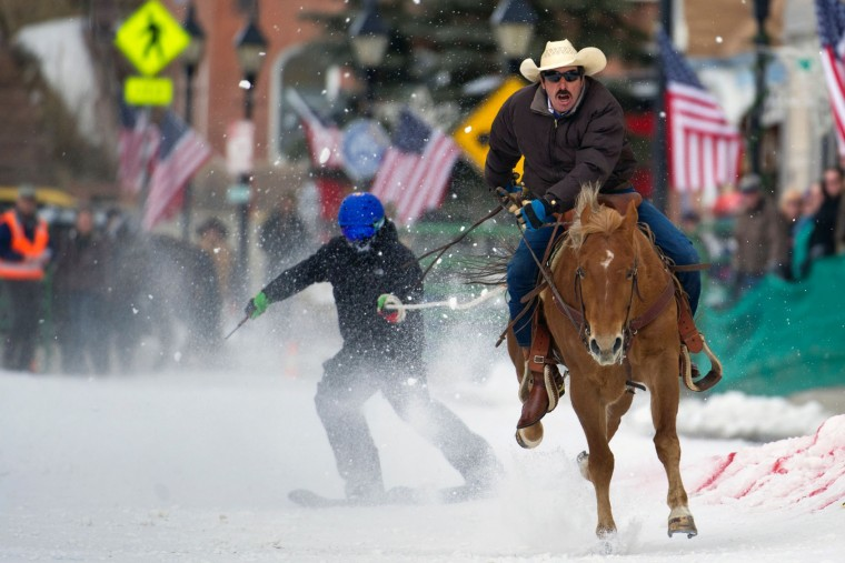 Rider Jorge Calzadillas races down Harrison Avenue while towing a skier during the 68th annual Leadville Ski Joring weekend competition on March 5, 2017 in Leadville, Colorado. Skijoring, which has its origins as a competitive sport in Scandinavia, has been adapted over the years to include a team made up of a rider and skier who must navigate jumps, slalom gates, and the spearing of rings for points. Leadville, with an elevation of 10,152 feet (3,094 m), the highest incorporated city in North America, has been hosting skijoring competitions since 1949. (Jason Connolly/AFP/Getty Images)