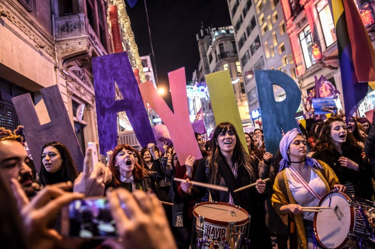 "People hold up letters reading ""No"" as they march down Istiklal Avenue during a feminist night march to mark International Women's Day in Istanbul on March 8, 2017. (OZAN KOSE/AFP/Getty Images)"
