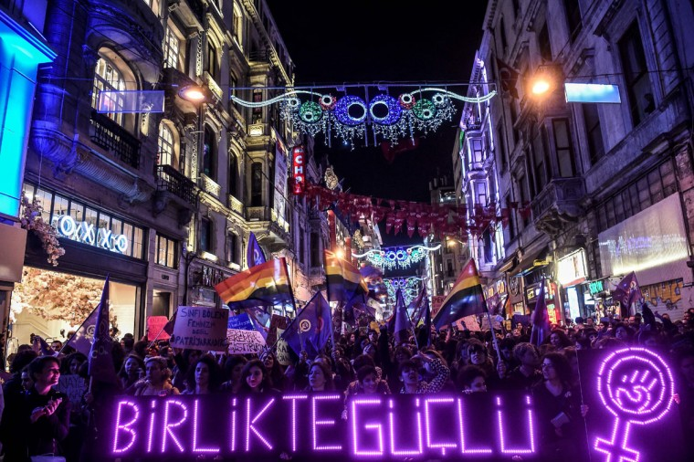 "People hold a neon sign reading ""Together, stronger"" as they march down Istiklal Avenue during a feminist night march to mark International Women's Day in Istanbul on March 8, 2017. (OZAN KOSE/AFP/Getty Images)"