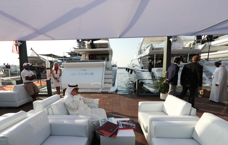 Visitors check boats docked at the Dubai International Marine Club during the Gulf emirate's international Boat Show on February 28, 2017. (KARIM SAHIB/AFP/Getty Images)