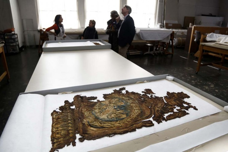 "A fragment of a Barberini tapestry that was damaged in a 2001 fire is carefully preserved at the Textile Conservation Laboratory at the Cathedral of St. John the Divine in New York, Wednesday, March 22, 2017. Experts at the cathedral just spent 16 years sprucing up its super-size wall hangings with a labor-intensive process that uses dental probes, tweezers and other tools. Now the historic house of worship is inviting the public to enjoy the fruits of its labors. An exhibit called ""The Barberini Tapestries, Scenes from the Life of Christ"" runs through June 25. (AP Photo/Seth Wenig)"