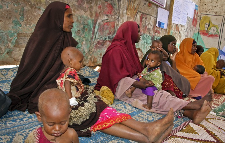 In this photo taken Saturday, March 25, 2017, Somali women and their malnourished children attend a health center in Baidoa, Somalia. Somalia's drought is threatening 3 million lives according to the U.N. and in recent months aid agencies have been scaling up their efforts but say more support is urgently needed to prevent the crisis from worsening. (AP Photo/Farah Abdi Warsameh)
