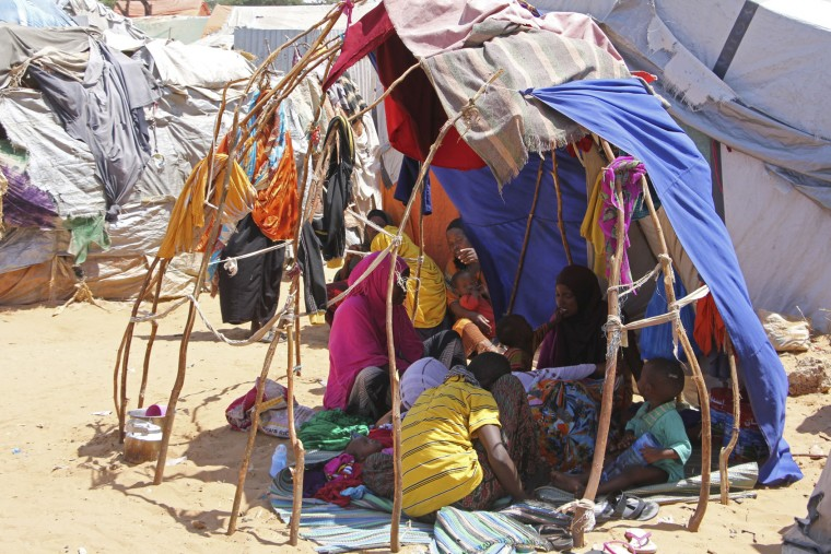 Newly displaced Somali women and children rest in a makeshift shelter in a camp outside of Mogadishu, Somalia, Monday, March, 27, 2017. Somalia's drought is threatening 3 million lives according to the U.N. and in recent months aid agencies have been scaling up their efforts but say more support is urgently needed to prevent the crisis from worsening. (AP Photo/Farah Abdi Warsameh)