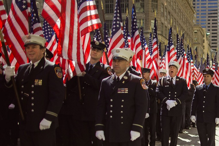 Firefighters march up Fifth Avenue during the St. Patrick's Day Parade, Friday, March 17, 2017, in New York. New York City was awash in green and Irish pride as throngs celebrated at the annual St. Patrick's Day Parade in Manhattan. (AP Photo/Andres Kudacki)