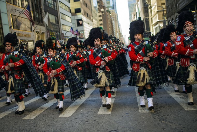 Bagpipers march up Fifth Avenue during the St. Patrick's Day Parade, Friday, March 17, 2017, in New York. New York City was awash in green and Irish pride as throngs celebrated at the annual St. Patrick's Day Parade in Manhattan. (AP Photo/Andres Kudacki)