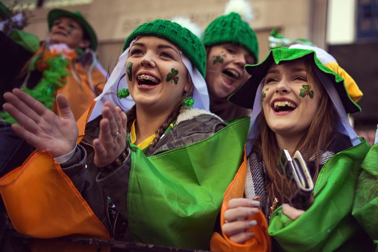 Spectators watch as revelers march up Fifth Avenue during the St. Patrick's Day Parade, Friday, March 17, 2017, in New York. New York City was awash in green and Irish pride as throngs celebrated at the annual St. Patrick's Day Parade in Manhattan. (AP Photo/Andres Kudacki)