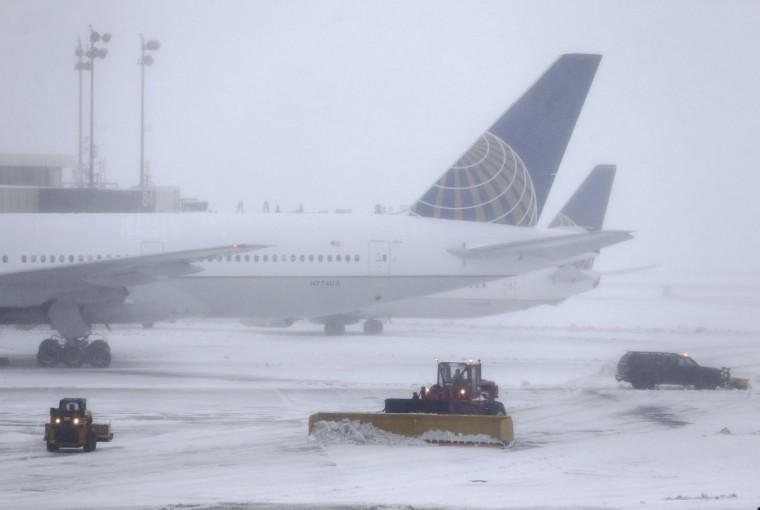 Snowplows work to keep the grounds clear at Newark Liberty International Airport in Newark, N.J., Tuesday, March 14, 2017. A storm pounded the Northeast with more than a foot of snow in places Tuesday, paralyzing much of the Washington-to-Boston corridor after a remarkably mild February had lulled people into thinking the worst of winter was over. (AP Photo/Seth Wenig)