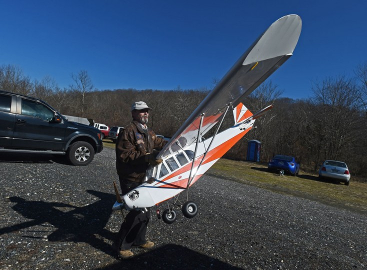 Arthur Pearce, of Bel Air, moves one of his 1/3 scale model airplanes into a race car trailer. (Kenneth K. Lam/Baltimore Sun)