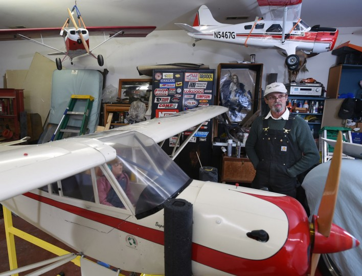Arthur Pearce, of Bel Air, is surrounded by several of his model airplanes at the Pete Crouse Hanger. (Kenneth K. Lam/Baltimore Sun)