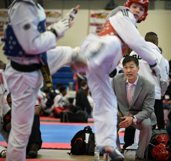"Yong Seong ""CJ"" Chang watches student Kyle Powers (red), of Kingsville, in sparring contest. Over 500 competed in the First Maryland Governor's Cup Taekwondo Championship hosted by the Maryland State Taekwondo Association at the APGFCU Arena Harford Community College. Competitors, ages from 3 to over 60 and from as far as Maine, competed in forms, board breaking and sparring in a full day of contests. All proceeds from the championship will be donated to the Children's Cancer Foundation (CCF). (Kenneth K. Lam/The Baltimore Sun)"