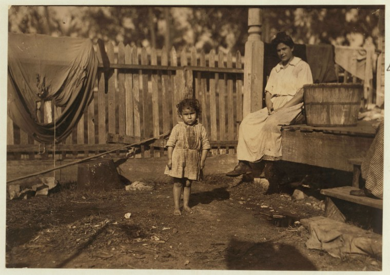 "Alma Crosien, three-year-old daughter of Mrs. Cora Croslen, of Baltimore. Both work in the Barataria Canning Company. The mother said, ""I'm learnin' her the trade."" Location: Biloxi, Mississippi. 1911 February (Lewis Hine/Photo courtesy LOC)"