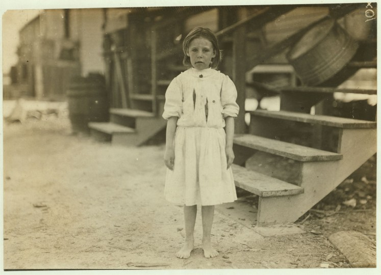 Annie Delcher, eight-year-old oyster shucker from Baltimore. Location: Dunbar, Louisiana. 1911 March. (Lewis Hine/Photo courtesy LOC)