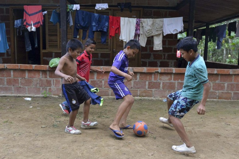 "Indigenous children play soccer in Mocoa, Putumayo department, Colombia on April 4, 2017. Meanwhile, looting has become a problem in some areas. Local officials urged the government to dispatch more police and troops to secure the region and prevent the looting of abandoned homes. ""What the mudslides didn't carry away, the thieves did,"" one survivor of the disaster, Juan Luis Hernandez, 33, told AFP in the devastated San Miguel neighborhood of Mocoa. (LUIS ROBAYO/AFP/Getty Images)"