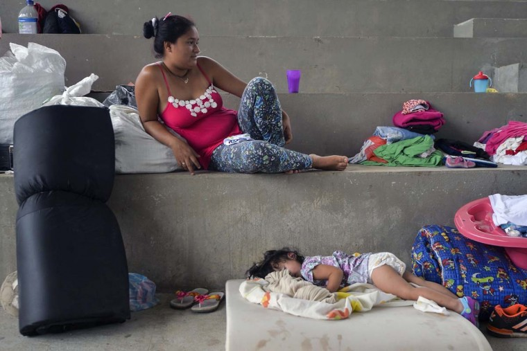 A young woman and her daughter rest at a shelter for victims of the mudslides caused by heavy rains in Mocoa, Putumayo department, southern Colombia, on April 5, 2017. A state of economic emergency has been declared in the town of Mocoa in southern Colombia, after mudslides left more than 290 people dead. And local officials urged the government to dispatch more police and troops to secure the region and prevent the looting of abandoned homes. (LUIS ROBAYO/AFP/Getty Images)