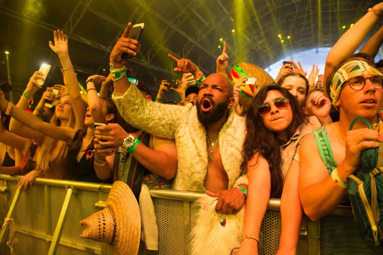Fans of DJ Khaled dance during his performance at the Coachella Valley Music And Arts Festival on April 16, 2017 in Indio, California. (Valerie Macon/AFP/Getty Images)