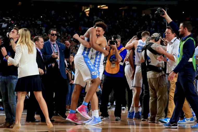 Tony Bradley #5 and Shea Rush #11 of the North Carolina Tar Heels celebrate after defeating the Gonzaga Bulldogs during the 2017 NCAA Men's Final Four National Championship game at University of Phoenix Stadium on April 3, 2017 in Glendale, Arizona. The Tar Heels defeated the Bulldogs 71-65. (Photo by Ronald Martinez/Getty Images)