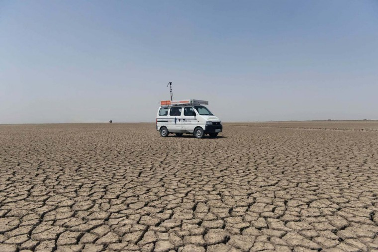 This picture taken on April 7, 2017 shows a 'Zero Connect' programme van driving on parched earth arriving for a tent school workshop with the children of Indian salt pan workers in the Little Rann of Kutch (LRK) region of Gujarat some 180km west of Ahmedabad. The children of Indian salt pan workers, drawn from the Agariya community in Gujarat state, accompany their parents in the remote and arid Little Rann of Kutch (LRK) region for nearly eight months of the year during the salt farming season. The 'Zero Connect' initiative provides basic education for the children in a joint initiative by the Agaria Heet Rakshak Manch, Digital Empowerment Foundation, Internet Society and Wireless for Communities groups. The initiative runs mobile workshops for the children, providing online access and education materials. (SAM PANTHAKY/AFP/Getty Images)