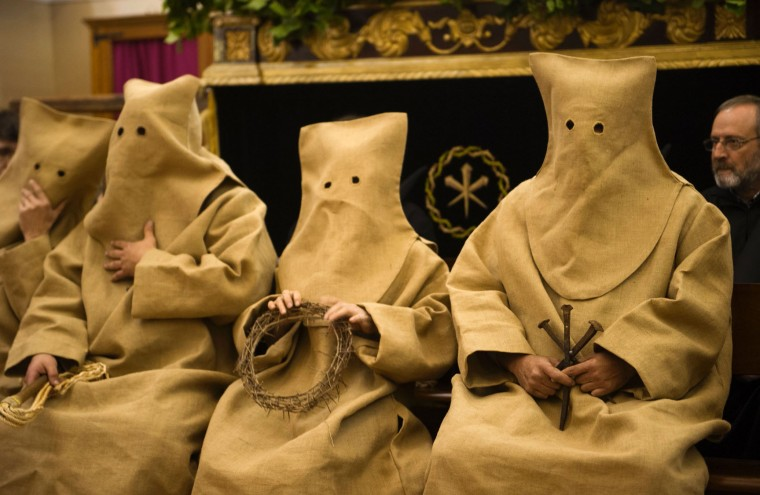 Penitents of the 'Silencio del Santisimo Cristo del Rebate' brotherhood, called 'Ensacado' because of the bag like cover shief, take part during a Holy Week procession in the Spanish village of Tarazona on April 11, 2017. Christian believers around the world mark the Holy Week of Easter in celebration of the crucifixion and resurrection of Jesus Christ. (Ander Gillenea/AFP/Getty Images)
