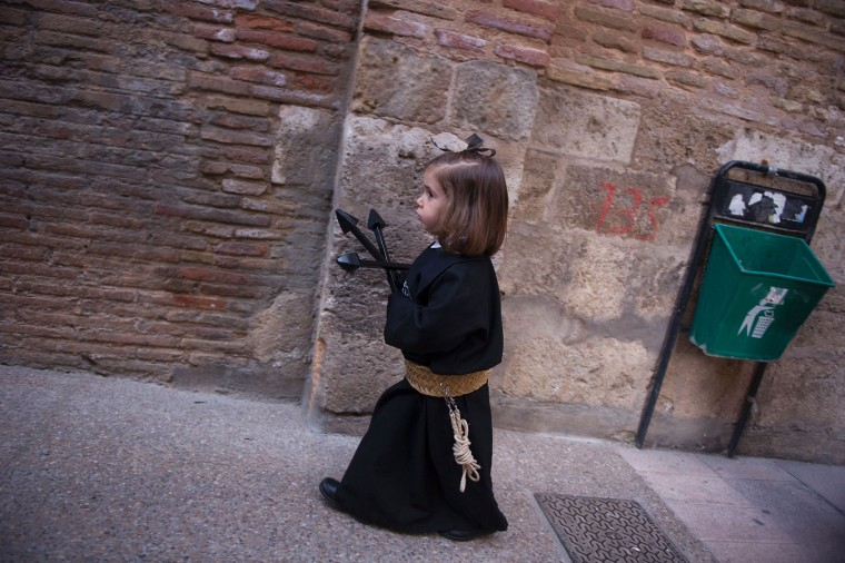 A child penitent of the 'Silencio del Santisimo Cristo del Rebate' brotherhood takes part during a Holy Week procession in the Spanish village of Tarazona on April 11, 2017. Christian believers around the world mark the Holy Week of Easter in celebration of the crucifixion and resurrection of Jesus Christ. (Ander Gillenea/AFP/Getty Images)