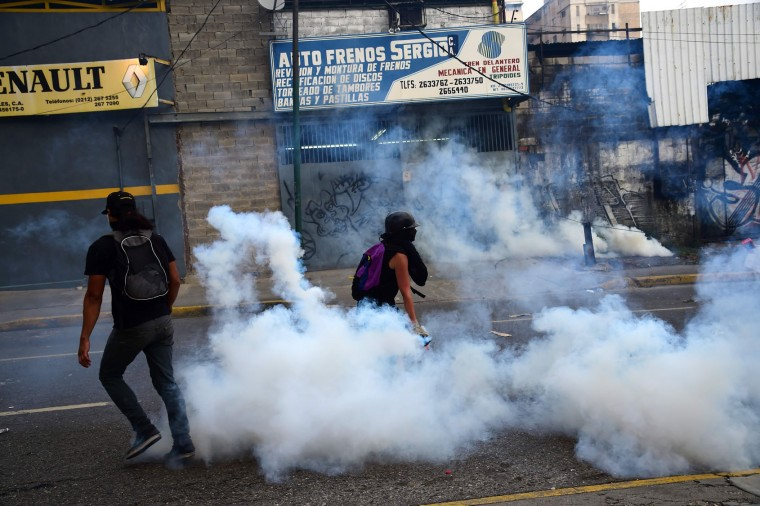 Demonstrators clash with the police during a rally against Venezuelan President Nicolas Maduro, in Caracas on April 19, 2017. Venezuelans took to the streets Wednesday for massive demonstrations for and against President Nicolas Maduro, whose push to tighten his grip on power has triggered deadly unrest that has escalated the country's political and economic crisis. (Ronaldo Schemidt/AFP/Getty Images)