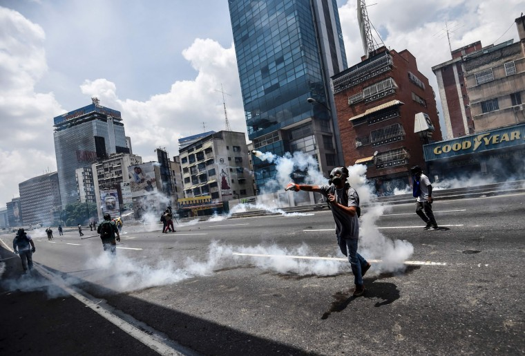 Demonstrators clash with the police during a rally against Venezuelan President Nicolas Maduro, in Caracas on April 19, 2017. Venezuelans took to the streets Wednesday for massive demonstrations for and against President Nicolas Maduro, whose push to tighten his grip on power has triggered deadly unrest that has escalated the country's political and economic crisis. (Juan Barreto/AFP/Getty Images)