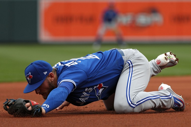 Josh Donaldson #20 of the Toronto Blue Jays cannot make a play in the first inning against the Baltimore Orioles during their Opening Day game at Oriole Park at Camden Yards on April 3, 2017 in Baltimore, Maryland (Photo by Patrick Smith/Getty Images)