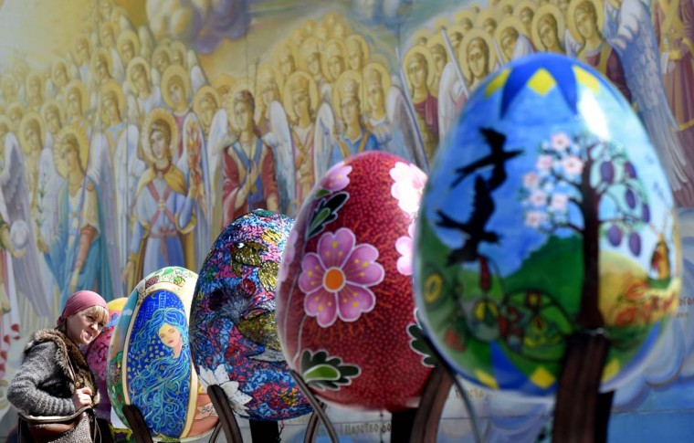 A woman looks at huge Easter eggs as they walk in the open air festival in the center of Kiev on April 12, 2017. Some 500 traditional Ukrainian pysankas, painted Easter eggs, are presented in the center of Kiev before the celebration of the Easter, main holiday of the Orthodox church, on April 16. (SERGEI SUPINSKY/AFP/Getty Images)