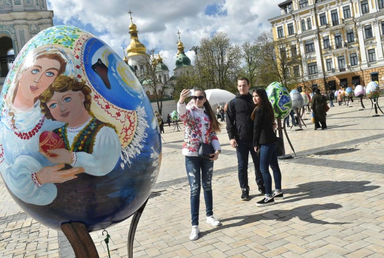Visitors pose for a selfie next to giant Easter eggs as they walk in the open air festival in the center of Kiev on April 12, 2017. Some 500 traditional Ukrainian pysankas, painted Easter eggs, are presented in the center of Kiev before the celebration of the Easter, main holiday of the Orthodox church, on April 16. (SERGEI SUPINSKY/AFP/Getty Images)