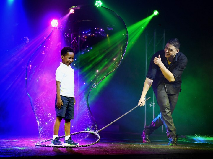 Bubble artist Deni Yang shrouds a boy in a bubble during his Mega Bubblefest Laser Show at the Discovery Cube Science Center in Santa Ana, California, on April 6, 2017. Deni, who is the son of famed bubble master Fan Yang, has followed in his father's footsteps and travels the world performing his bubble shows. His family holds the world record for largest soap bubble, measuring 167 feet long, that was created in Beijing, China in 2009. (Mark Ralston/AFP/Getty Images)