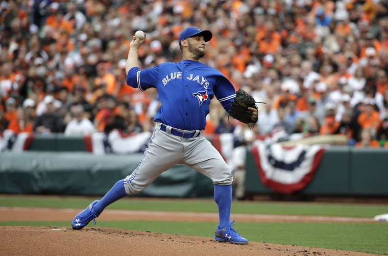 Toronto Blue Jays starting pitcher Marco Estrada throws to the Baltimore Orioles in the first inning of an opening day baseball game in Baltimore, Monday, April 3, 2017. (AP Photo/Patrick Semansky)