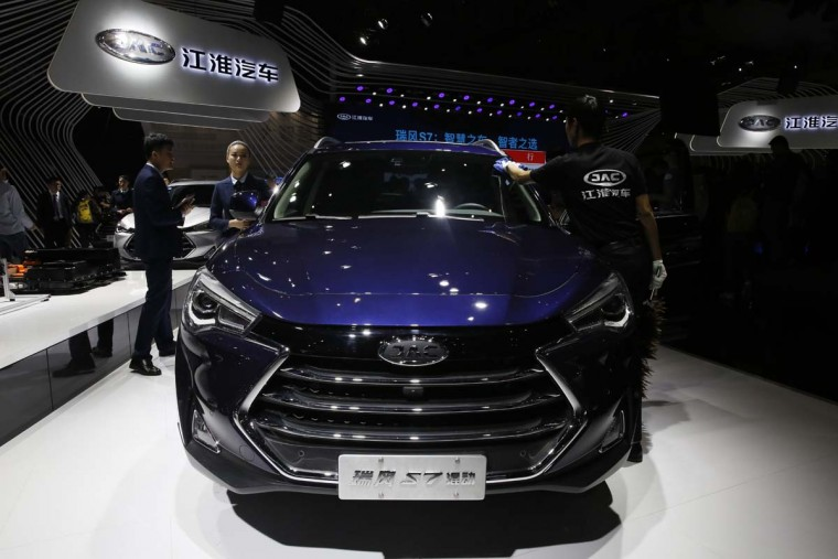 The S7 from Chinese automaker JAC is displayed during the Auto Shanghai 2017 show at the National Exhibition and Convention Center in Shanghai, China, Wednesday, April 19, 2017. Models on display at Auto Shanghai 2017, the global industry's biggest marketing event of the year, reflect the conflict between Beijing's ambitions to promote environmentally friendly propulsion and Chinese consumers' love of hulking, fuel-hungry SUVs. (AP Photo/Ng Han Guan)