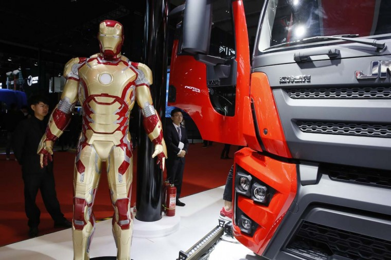 The Iron Man character is displayed to promote a truck by Chinese automaker JMC during the Auto Shanghai 2017 show at the National Exhibition and Convention Center in Shanghai, China, Wednesday, April 19, 2017. Models on display at Auto Shanghai 2017, the global industry's biggest marketing event of the year, reflect the conflict between Beijing's ambitions to promote environmentally friendly propulsion and Chinese consumers' love of hulking, fuel-hungry SUVs. (AP Photo/Ng Han Guan)